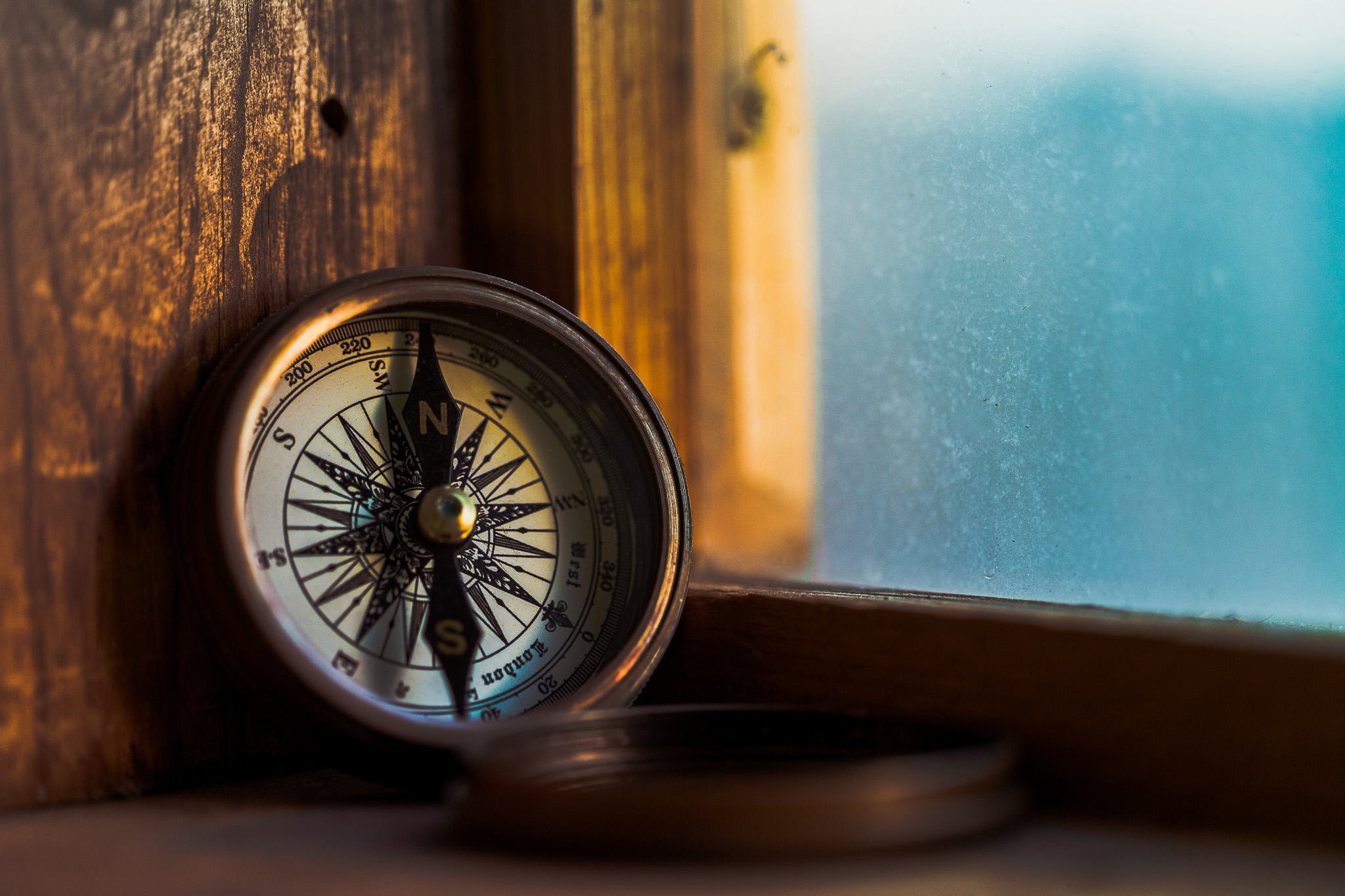 Rustic Compass on windowsill tourism adventure travel