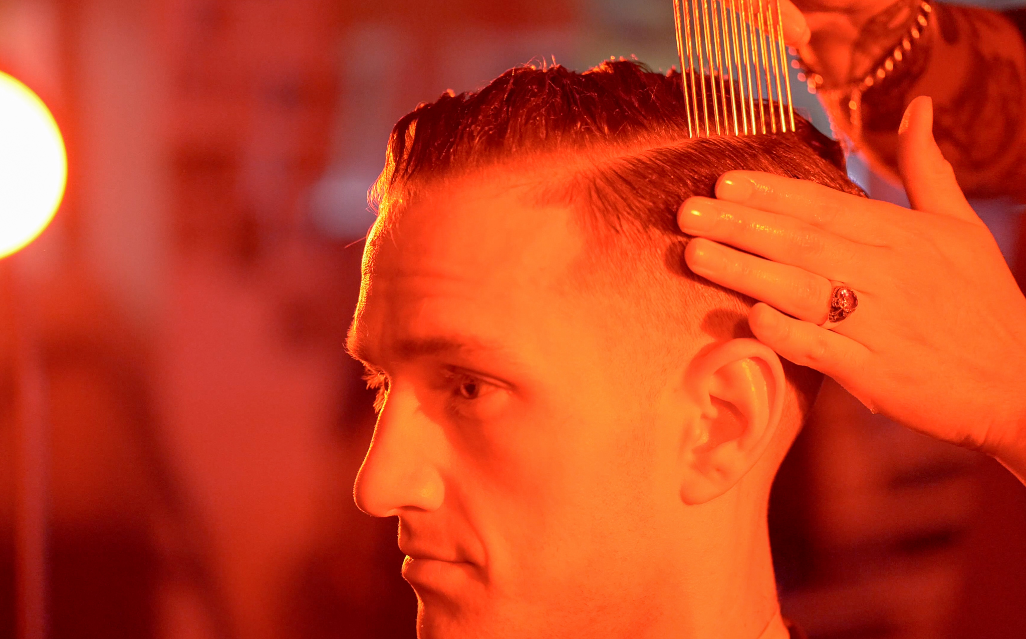 Club Hipster Barbershop parting hair with comb pic