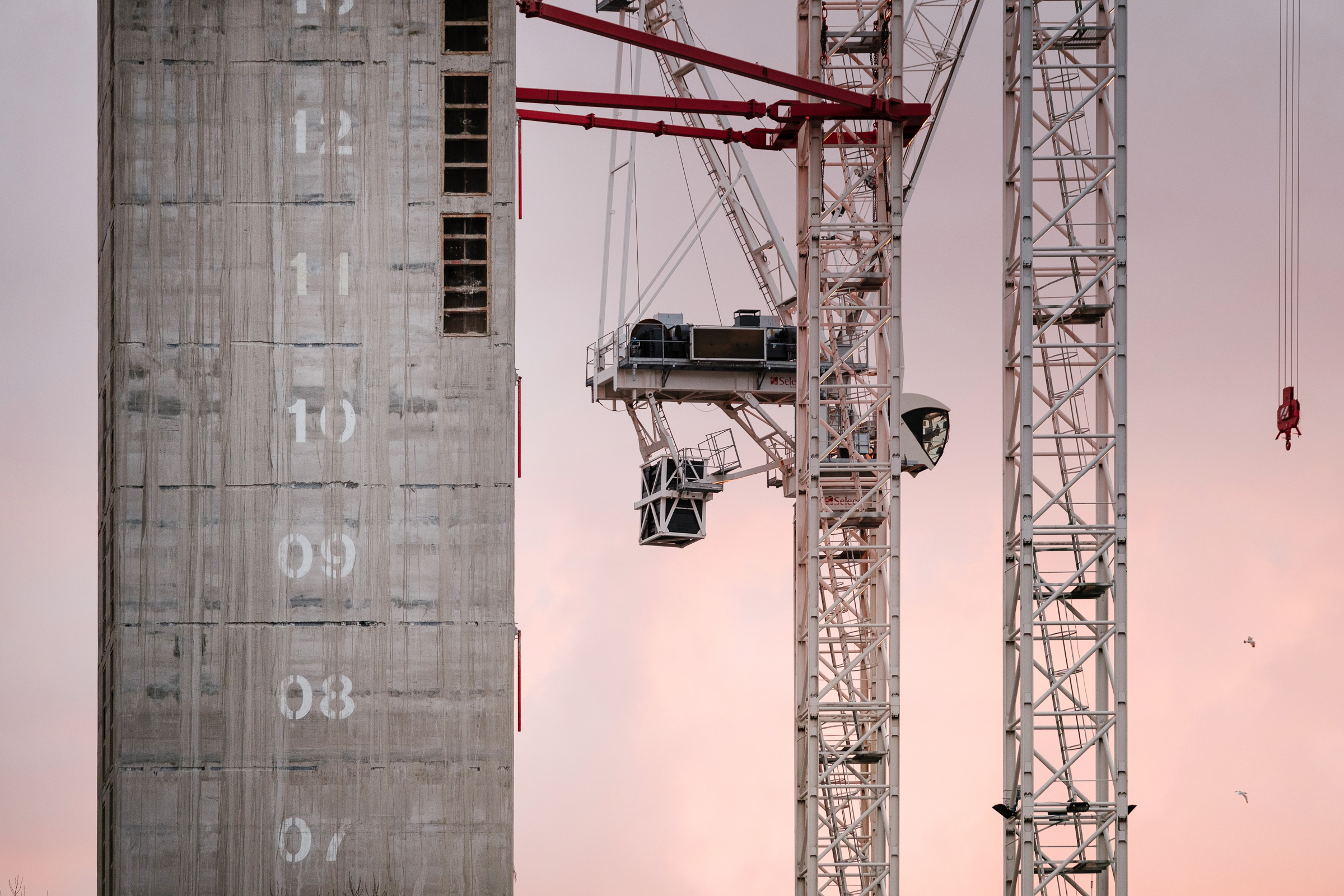 Aerial drone photograph of large crane on construction site