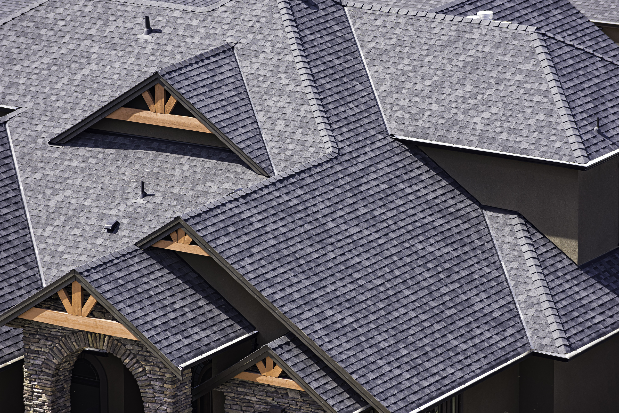 Drone aerial rooftop photo in a newly constructed subdivision in Washington, D.C. showing asphalt shingles and multiple roof lines