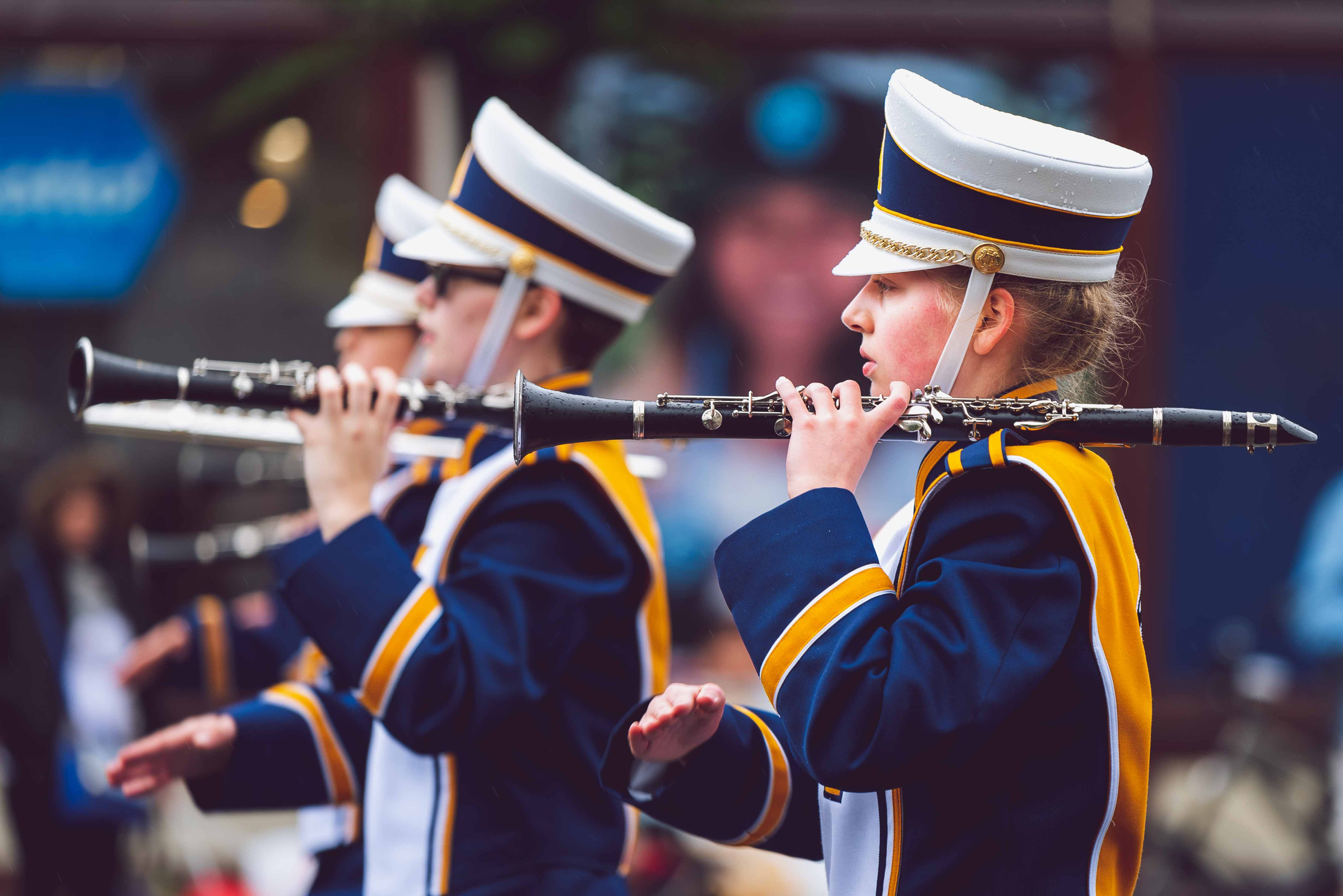 Clarinet players marching in town parade